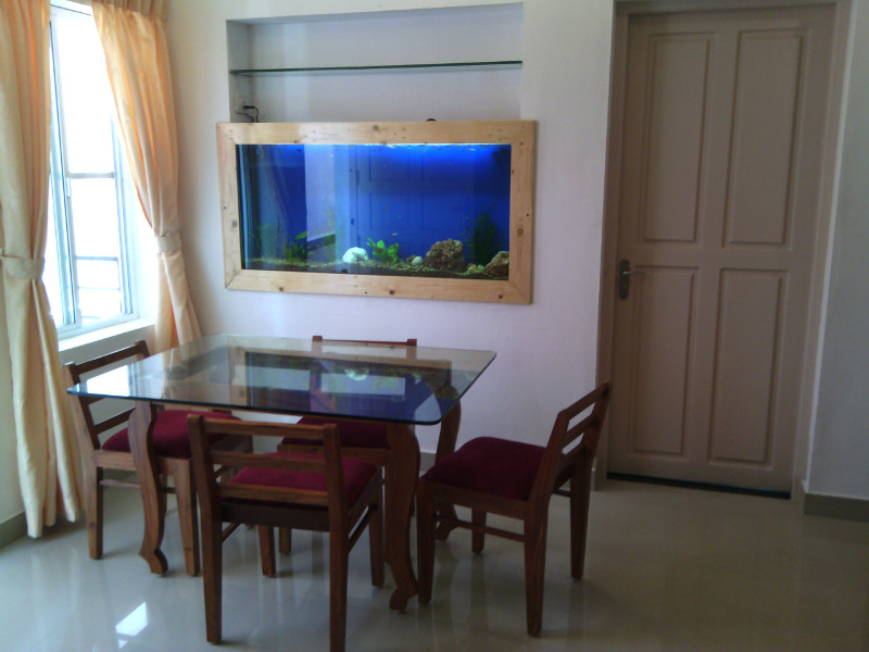 dining table and chairs in fort cochin home stay nathans holiday home